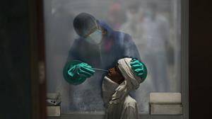 Fresh outbreaks are prompting worldwide moves to guard against the pandemic (Manish Swarup/AP)