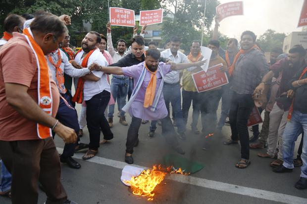 Supporters of Hindu right-wing Vishwa Hindu Parishad (VHP) burn a Pakistani flag during a protest at the recent targeted killings of civilians in Indian-controlled Kashmir (Ajit Solanki/AP)