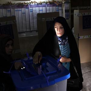 An Iraqi woman, the last voter in a polling centre in the Karrada area, casts her ballot just before polls closed in the country's provincial elections in Baghdad (AP)