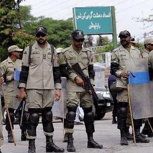 Pakistan's paramilitary force stand guard at one of Mr Musharraf's court appearances (AP)