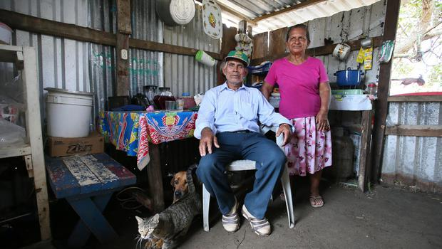 Candido Zaldivar Flores pictured with his wife Elvia Murcia de Zaldivar in the hut on the local church grounds where they now live. Their home was destroyed by waves during a storm at Cuyamel near San Pedro Sula, Honduras. Photo: Frank Mc Grath