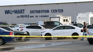 Crime tape blocks off a car park outside the Red Bluff Walmart distribution centre (Mike Chapman/The Record Searchlight via AP)