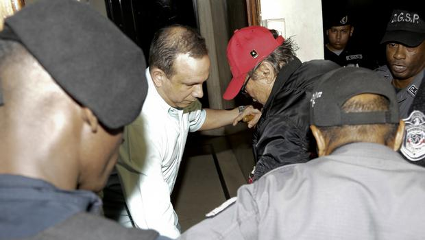 Manuel Noriega, wearing a red baseball cap, after being placed under house arrest in Panama City (Arnulfo Franco/AP)
