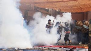 Indian police use tear gas to disperse supporters as they storm the ashram of controversial guru Sant Rampal (AP)