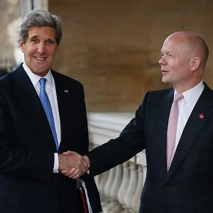 US Secretary of State John Kerry is greeted by Foreign Secretary William Hague at Lancaster House in London