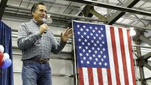 Former Republican presidential nominee Mitt Romney speaks at a campaign rally for US Senate candidate Dan Sullivan. (AP)