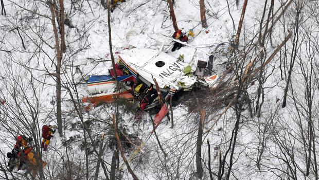 Rescuers at the scene of a helicopter crash in Nagano prefecture, central Japan (Daisuke Suzuki/Kyodo News via AP)