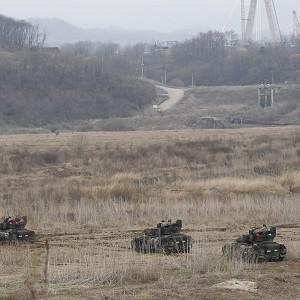 US army soldiers drive armored vehicles during annual military drills in Yeoncheon, South Korea, near the border with North Korea (AP)