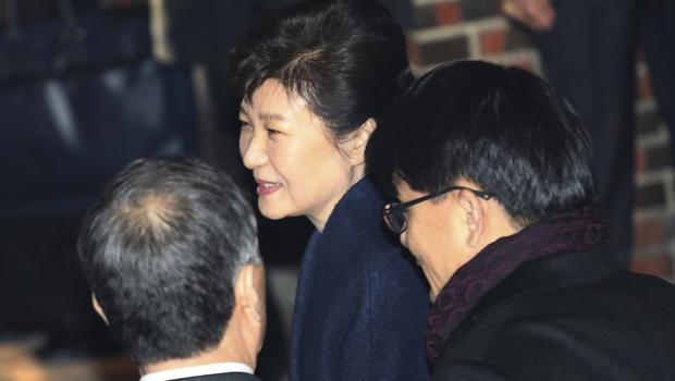 South Korean President Park Geun-hye, centre, smiles on arrival at her private home in Seoul