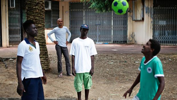 Migrants play soccer at the Franco-Italian border in Ventimiglia (AP Photo/Thibault Camus)