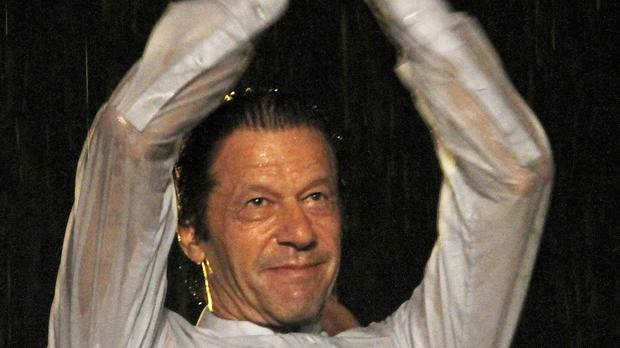 Imran Khan applauds his supporters during the anti government rally in Islamabad (AP)