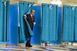 Kassym-Jomart Tokayev leaves a booth at a polling station (AP Photo/Alexei Filippov)