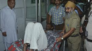 A man who was injured in a train accident is brought for treatment (Prabhjot Gill/AP)