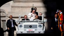 Pope Francis salutes the crowd as he arrives for his weekly general audience in St Peter's square at the Vatican this week. Photo: Getty