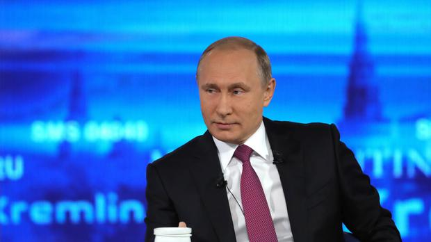 Russian president Vladimir Putin listens during his televised call-in show in Moscow (AP)