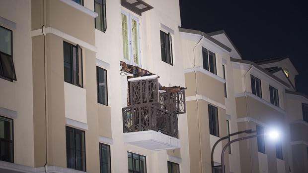 A fourth floor balcony rests on the balcony below after collapsing at the Library Gardens apartment complex in Berkeley, California (AP)