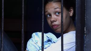Heather Mack holds her baby inside a cell before her trial over the murder of her mother in Bali (AP)