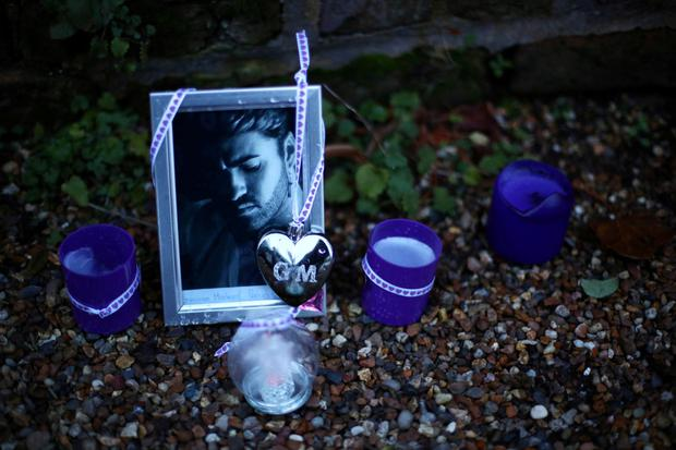 Death of an icon: Some of the tributes outside the London home of George Michael after his sister was found dead on Christmas Day. Photo: Hannah McKay/Reuters