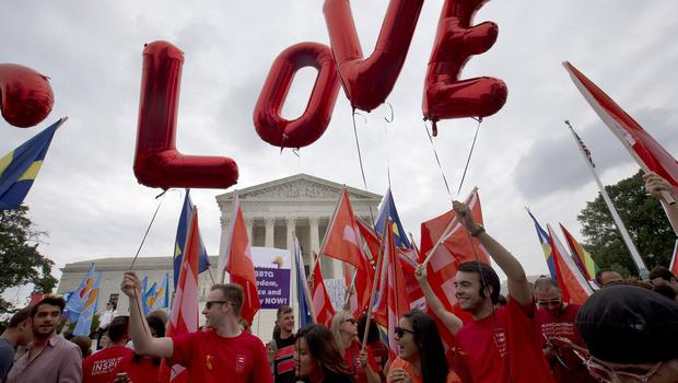 """Balloons spell out the word """"love"""" over the Supreme Court in Washington after the court declared that same-sex couples have a right to marry anywhere in the US (AP)"""