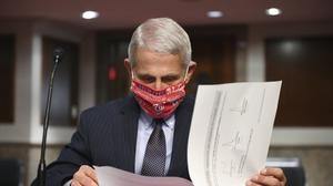 Dr Anthony Fauci has hit back at critics (Kevin Dietsch/Pool via AP)