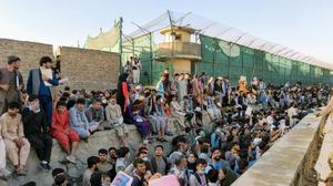 Crowds of people wait outside the airport in Kabul, Afghanistan August 25, 2021 in this picture obtained from social media. Twitter/DAVID_MARTINON via REUTERS