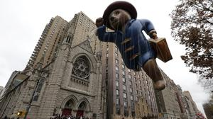 The Paddington Bear balloon cruises over Central Park West during the Macy's Thanksgiving Day Parade in New York (AP)