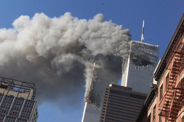 Smoke rises from the World Trade Centre after hijacked planes crashed into the towers on September 11 2001 (Richard Drew/AP)
