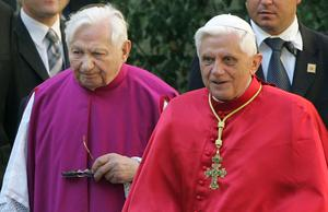 Then Pope Benedict XVI, right, walks with his brother priest Georg Ratzinger in Regensburg, southern Germany in 2006 (Dieter Endlicher/AP)