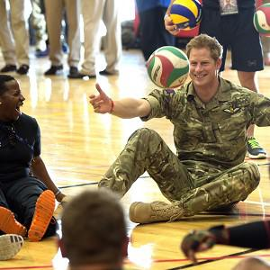 Prince Harry meets British soldiers competing in the warrior games and plays sitting volleyball with them in Colorado Springs (Arthur Edwards/The Sun /PA Wire)