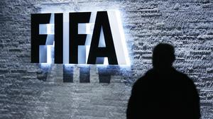 The Swiss Federal Office of Justice says US authorities suspect the Fifa officials of receiving or paying bribes totalling millions of dollars (Steffen Schmidt/Keystone/AP)