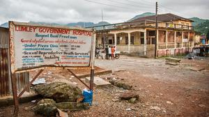 A sign showing directions to the Lumley Government Hospital, where doctor Olivet Buck worked before contracting the Ebola virus, near Freetown, Sierra Leone (AP)