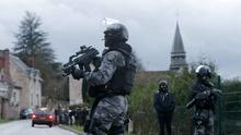 A member of the French GIPN intervention police forces secure a neighbourhood in Corcy, northeast of Paris. Photo: Reuters