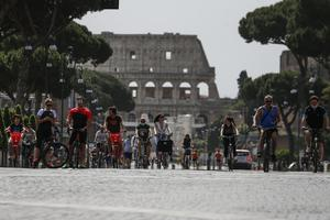 Cyclists near the Colosseum in Rome (Cecilia Fabiano/AP)