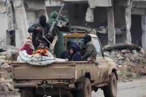 Rebel fighters ride on a pick-up truck in the town of al-Rai, Syria. Photo: Reuters