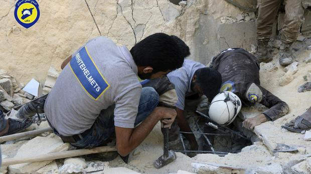 Syrian Civil Defence workers search underground in rebel-held eastern Aleppo, Syria. (Syrian Civil Defense- White Helmets via AP)