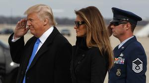 President-elect Donald Trump salutes as he and his wife Melania arrive at Andrews Air Force Base (AP/Evan Vucci)