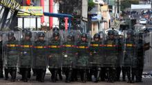 Soldiers advance on demonstrators attacking a police station during an anti-government protest in San Cristobal, Venezuela (AP)