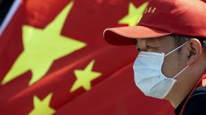 Donald Trump has insisted China 'must have' the highest Covid-19 death toll of any country, despite official figures (Ng Han Guan/AP)
