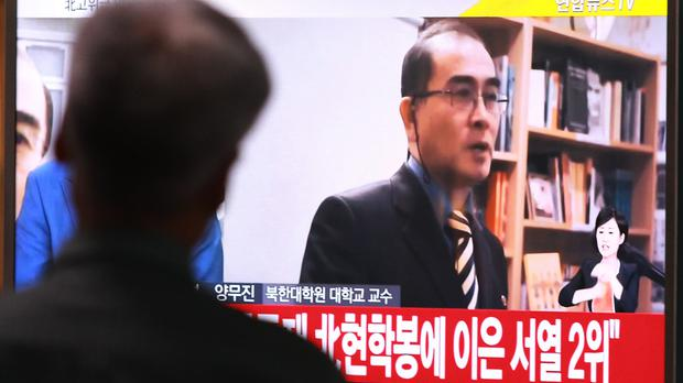 A man watches news of Thae Yong Ho's defection (AP)