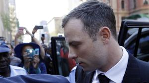 Pistorius as he arrived at court in Pretoria to hear the judge's verdicts (AP)