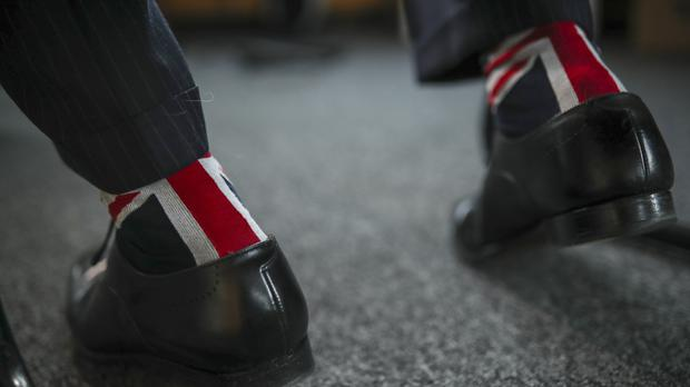 Nigel Farage wears socks with the Union flag as he speaks at the European Parliament in Brussels (Francisco Seco/AP)
