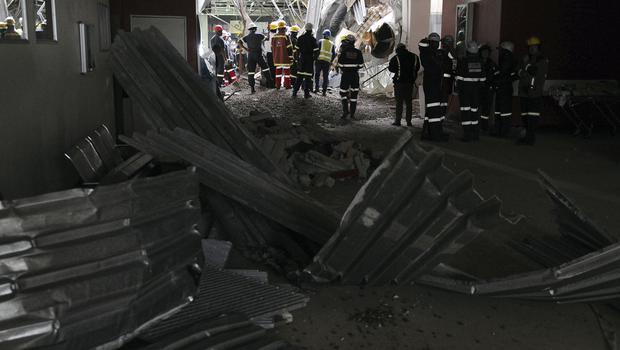Emergency staff work at the scene of a roof collapse at the Charlotte Maxeke Hospital in Johannesburg (AP)