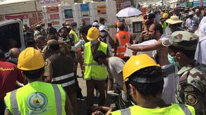 Rescuers respond to a stampede that killed and injured pilgrims in the holy city of Mina (Directorate of the Saudi Civil Defense agency via AP)