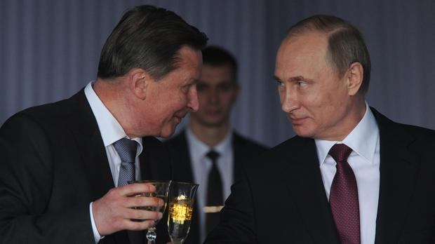 Vladimir Putin, right, talks with Sergei Ivanov during a reception celebrating the Day of Russia at the Kremlin in June (AP)