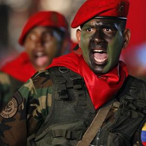 Soldiers march during a military parade after the inauguration ceremony for newly sworn-in President Nicolas Maduro in Caracas, Venezuela (AP)