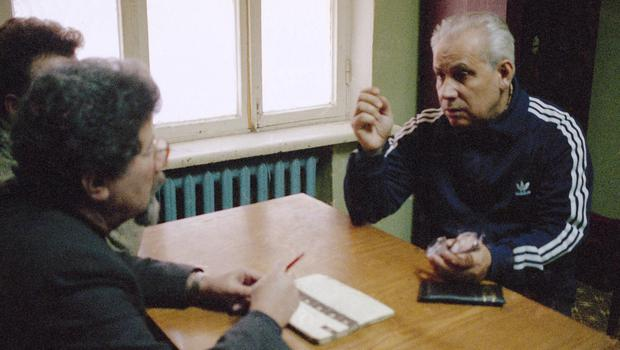 Anatoly Lukyanov, gestures to investigators in a room at the Matrosskaya Tishina prison in Moscow (AP)