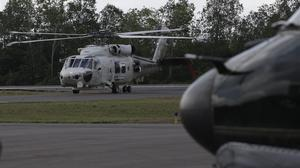 A Japan maritime self-defence force helicopter returns from a search operation for the victims of AirAsia Flight 8501 (AP)