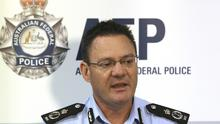 Michael Phelan tells the media that two Sydney men have been arrested by the Joint Counter Terrorism team in Sydney (AP)