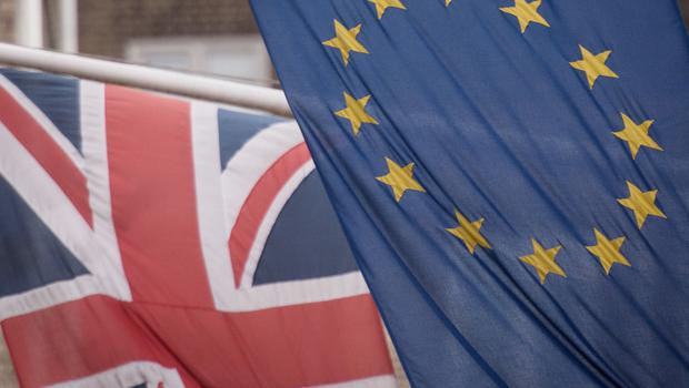 File photo dated 17/2/2016 of the EU and Union flags. Financial Services companies have shifted almost £800 billion of assets since the EU referendum.