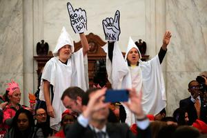 Protesters wearing white sheets shout at Sen. Jeff Sessions (R-AL) as he arrives for his confirmation hearing to be the U.S. attorney general Senate Judiciary Committee in the Russell Senate Office Building on Capitol Hill January 10, 2017 in Washington, DC